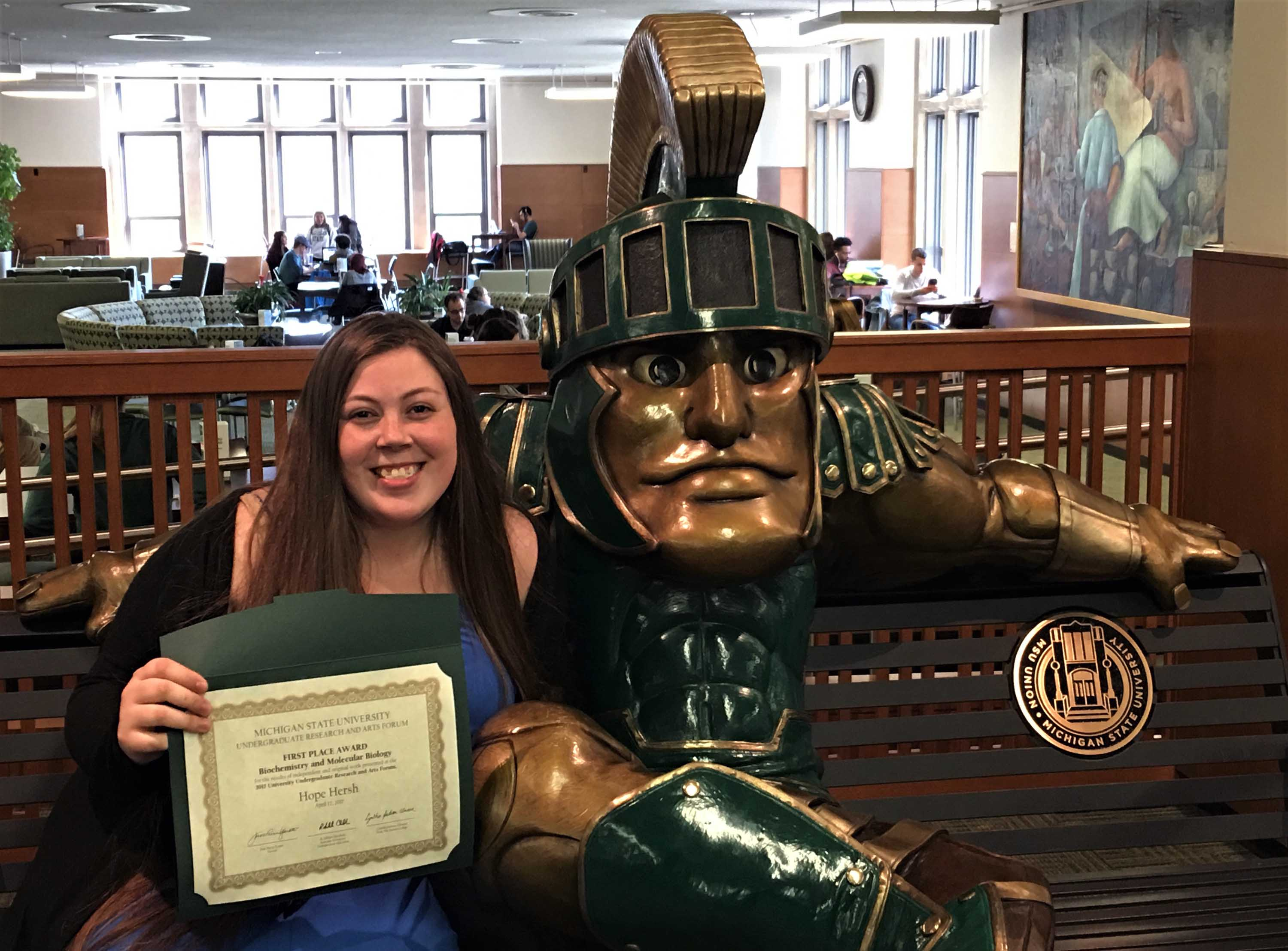 Hope with her award by Sparty statue