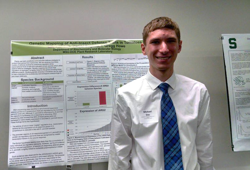 Image of Michael Das in front of his poster at the UURAF