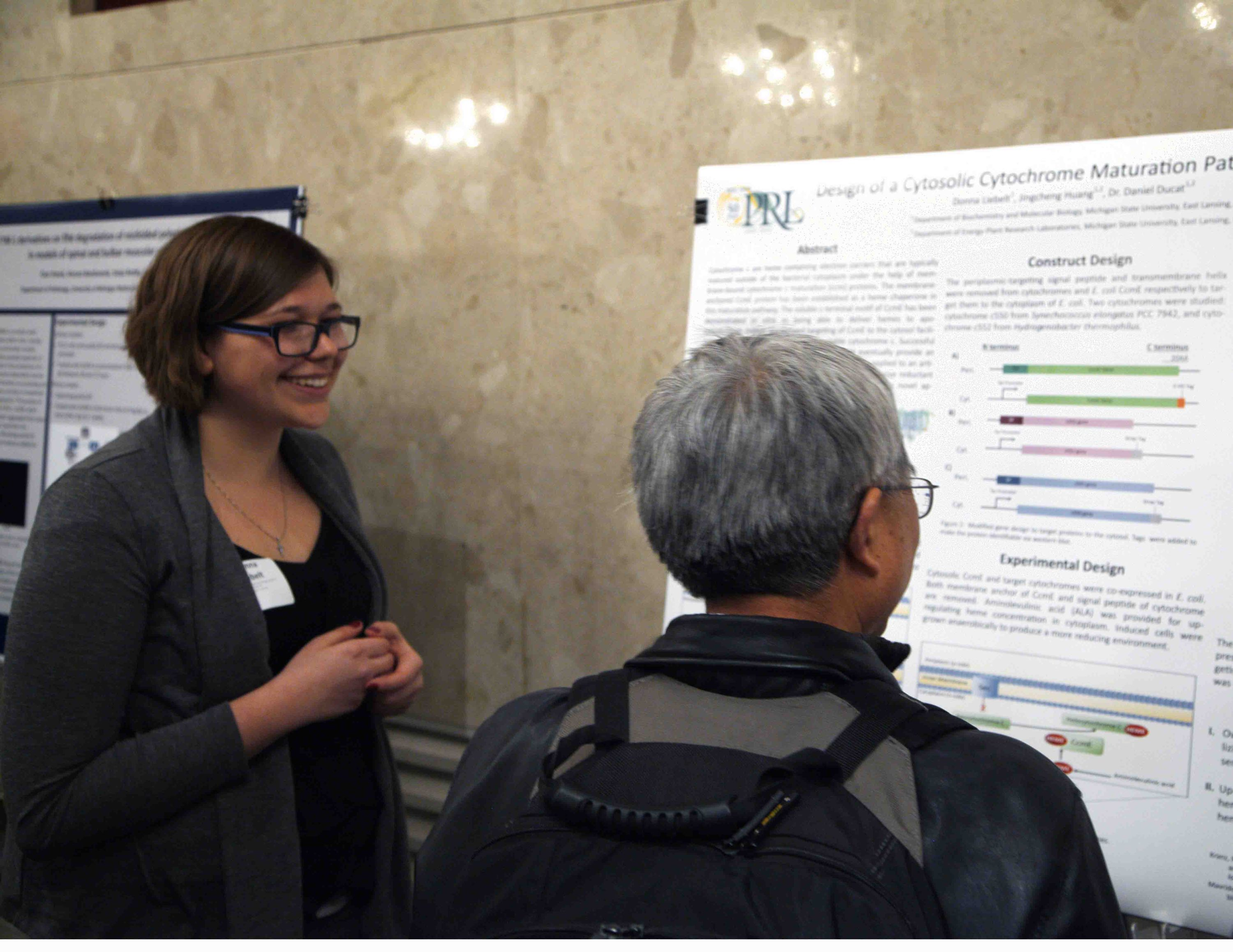 Image of Donna presenting her poster at the UURAF