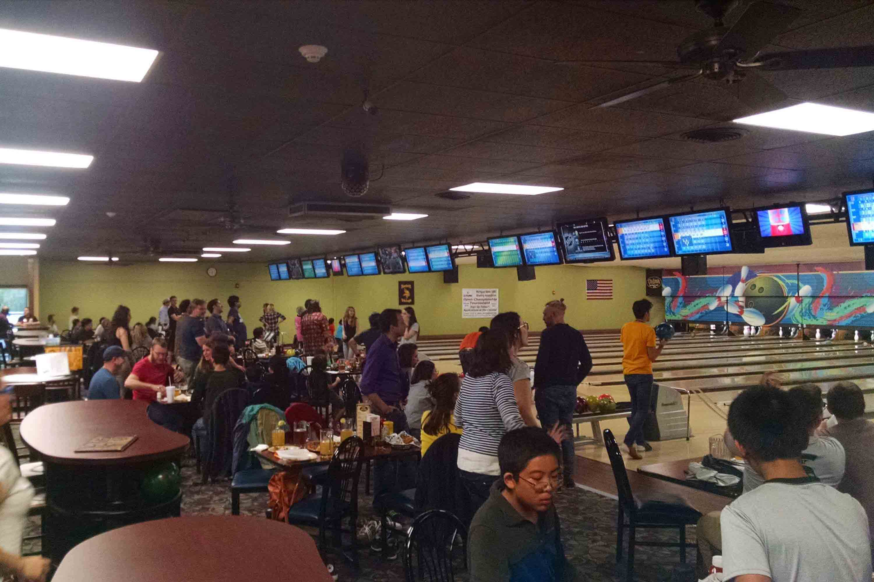 Bowlers having a good time. Parents and kids attended.
